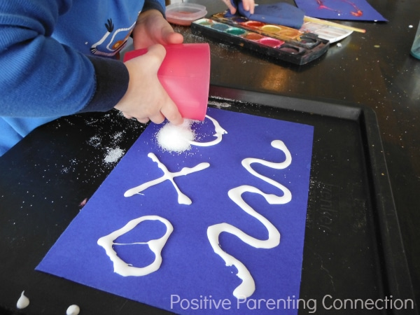Pouring Salt for Salt Painting from Positive Parenting Connection and B-InspiredMama.com