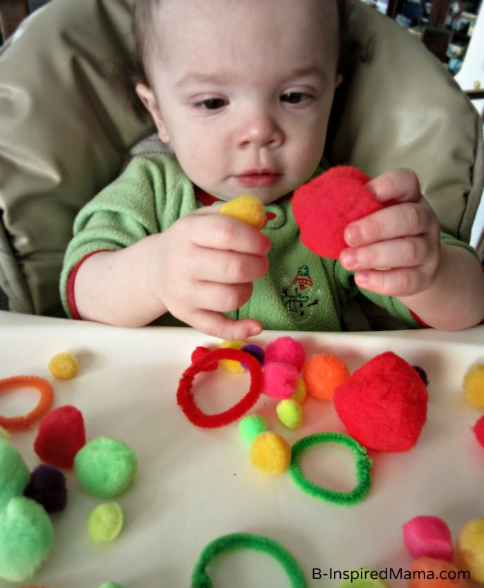 Comparing Circle Sizes during Toddler Sensory Play at B-InspiredMama.com