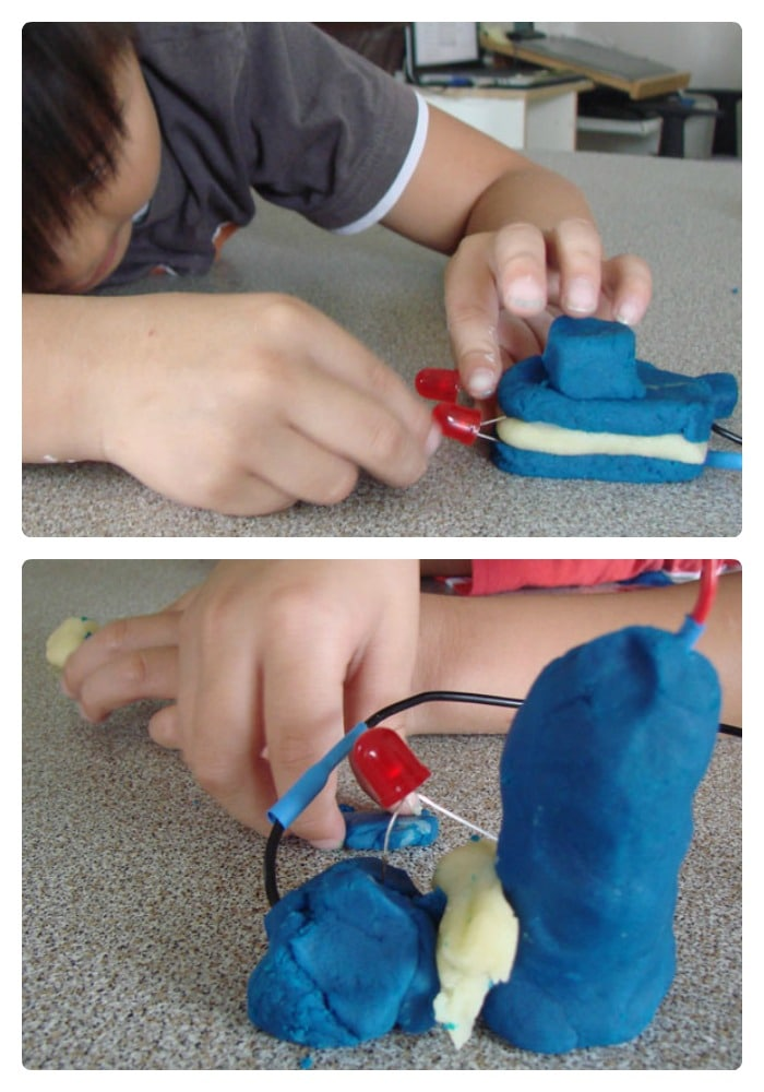 kids circuit building with play dough