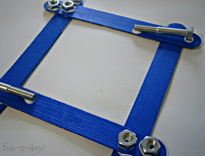 Making a Nuts & Bolts Frame Fathers Day Craft for Kids at B-InspiredMama.com