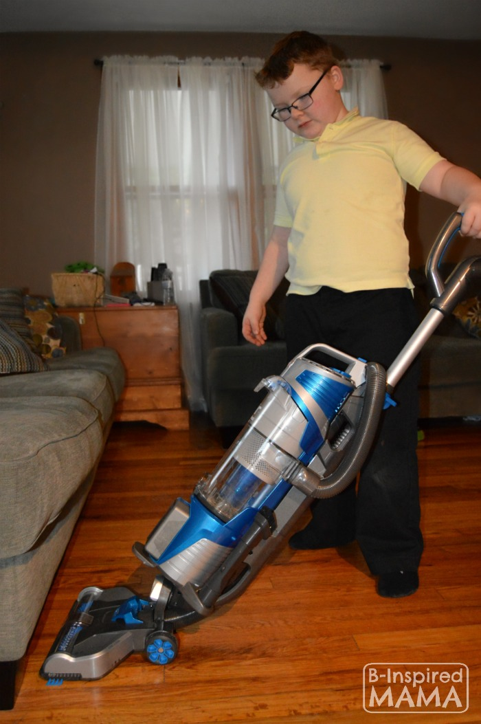 8 Cool Cleaning Games to Get the Kids to Help - Sawyer Loving the Hoover Vacuum - at B-Inspired Mama