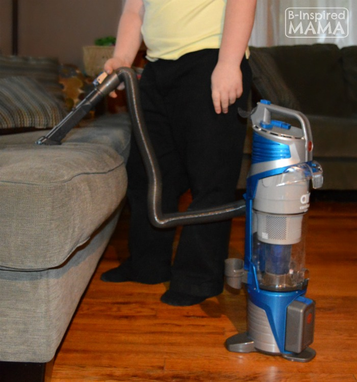 Some Cool Cleaning Games to Get the Kids to Help - Sawyer Vacuuming the Couch - at B-Inspired Mama