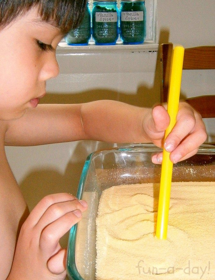 Kids Writing in a Citrus Sensory Tray at B-InspiredMama.com