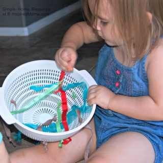 A Toddler Playing with a DIY Toy at B-Inspired Mama