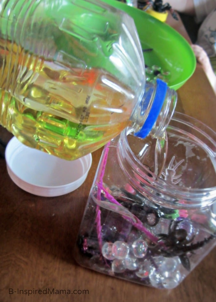 Filling our Sensory Bottles of Spiders and Insects for Kids at B-Inspired Mama