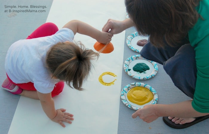 A Toddler Doing a Kids Thanksgiving Table Runner Art Project at B-Inspired Mama