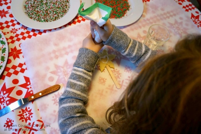 Kid Making Holiday Sugar Cookie Pops at B-Inspired Mama