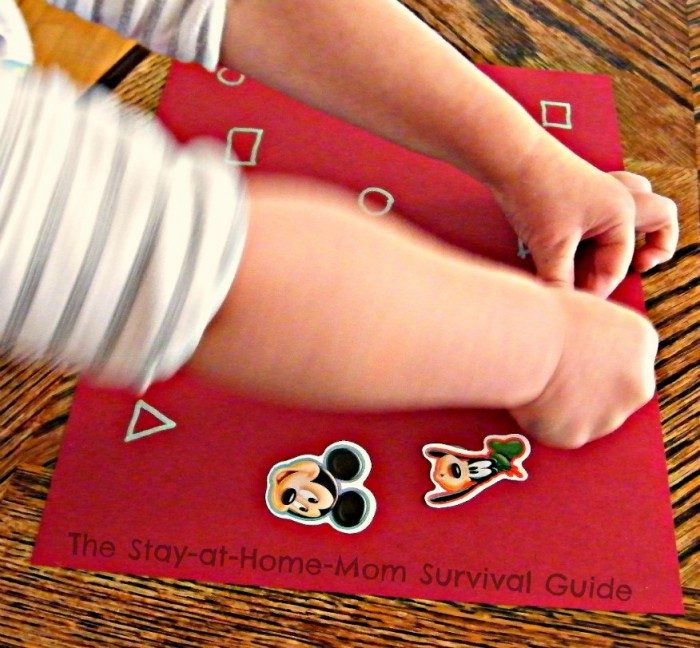 Placing Stickers - Learning Letters and Shapes with a Simple Sticker Activity - From The Stay-At-Home-Mom Survival Guide at B-Inspired Mama