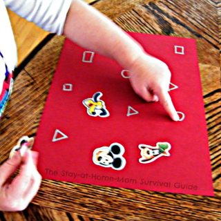 Pointing - Learning Letters and Shapes with a Simple Sticker Activity - From The Stay-At-Home-Mom Survival Guide at B-Inspired Mama