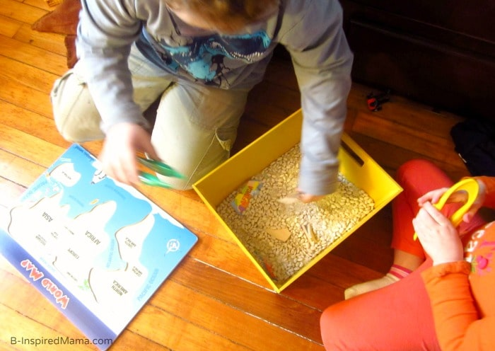 Geography for Kids Using a World Map Sensory Bin - B-Inspired Mama