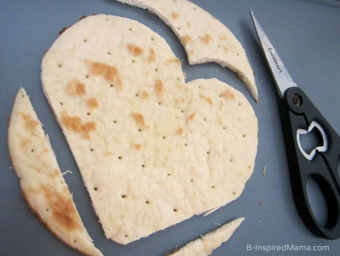cutting our heart shaped crust - Easy peasy homemade heart shaped Valentine's Day pizza - Not delivery!