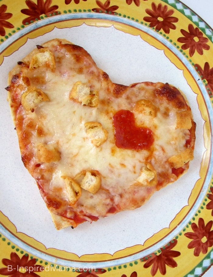 The kids will love this homemade heart shaped Valentine's Day pizza - Not delivery!