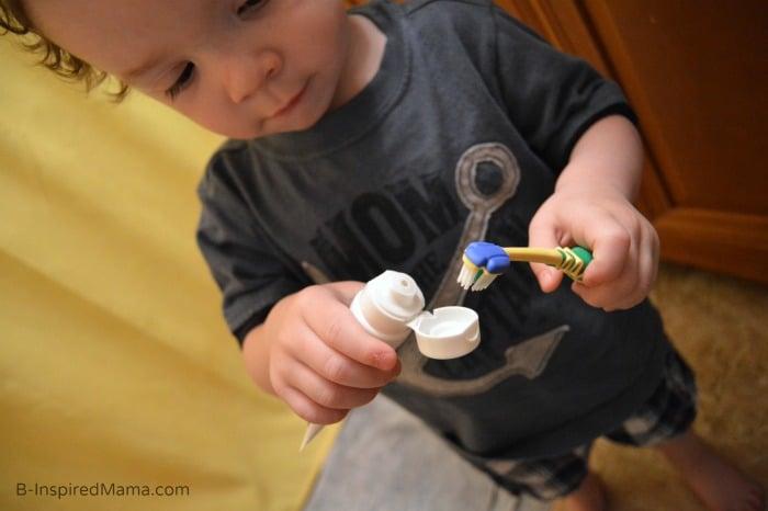 Doing It Himself + Toddler Teeth Brushing Tips at B-Inspired Mama