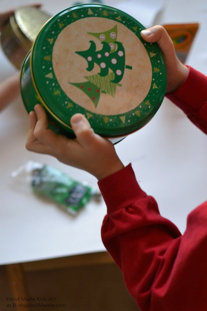 Shake Shake - Making Jingle Bell Painted Gift Tags - A Holiday Art Project for Kids at B-Inspired Mama