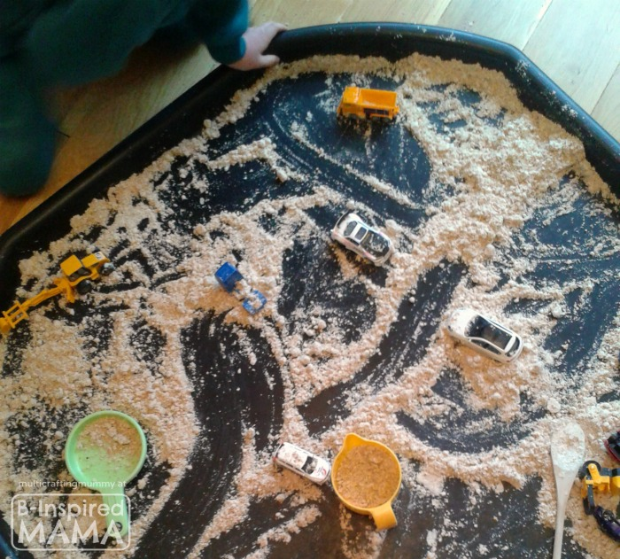 Calming Construction Site Sensory Play - with Diggers in DIY Moon Sand at B-Inspired Mama