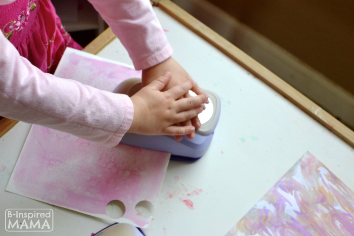 How to Make Stickers with Kids Art - Punching Out Shapes - at B-Inspired Mama