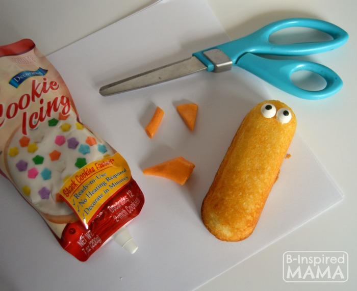 Adding Eyes and a Beak - Hatching Chick Easter Treats using Twinkies at B-Inspired Mama