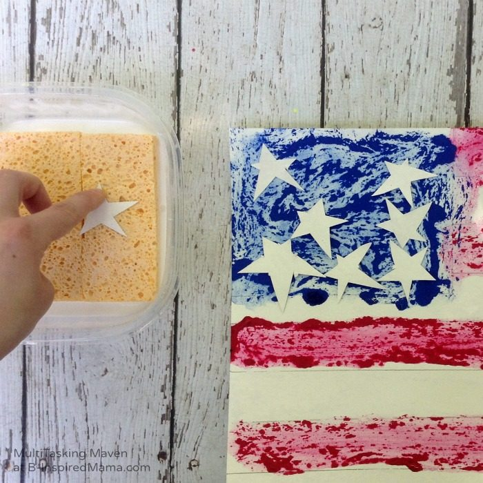 An Ice Paint American Flag Craft - Gluing on Stars - B-Inspired Mama