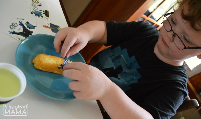 A Fun Kids Snack Full of Minions - Sawyer Making His Twinkie Minion - at B-Inspired Mama