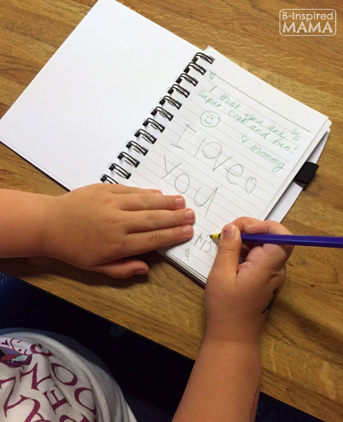 Priscilla Writing in Our Together Journal + Printable Writing Prompts for Kids at B-Inspired Mama