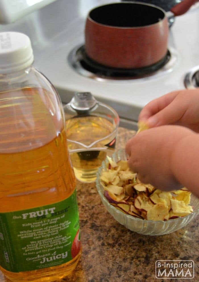 Kid-Friendly Apple Spice Cake Recipe - Priscilla Helping with the Apples - B-Inspired Mama