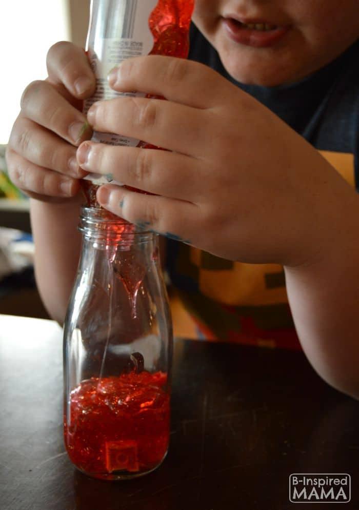 Making LEGO Sensory Bottles - B-Inspired Mama