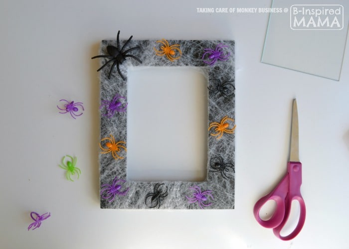 Spider Web Picture Frame Halloween Craft - Adding the Spiders - B-Inspired Mama