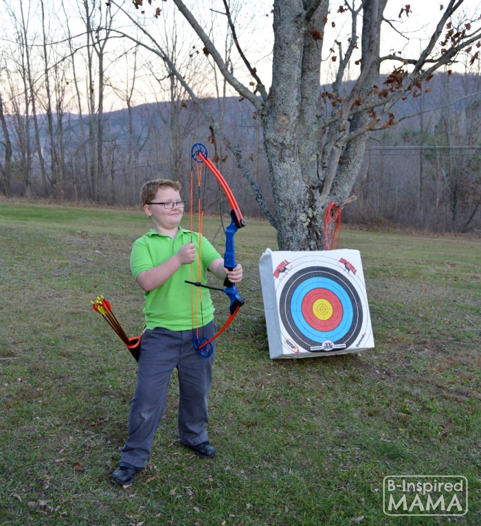 The Best Big Gifts for Kids - A 2015 Holiday Gift Guide - Sawyer with his New Genesis Bow - at B-Inspired Mama
