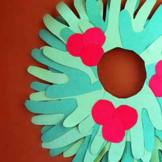 Cute Kids Handprint Wreath Christmas Craft - at B-Inspired Mama