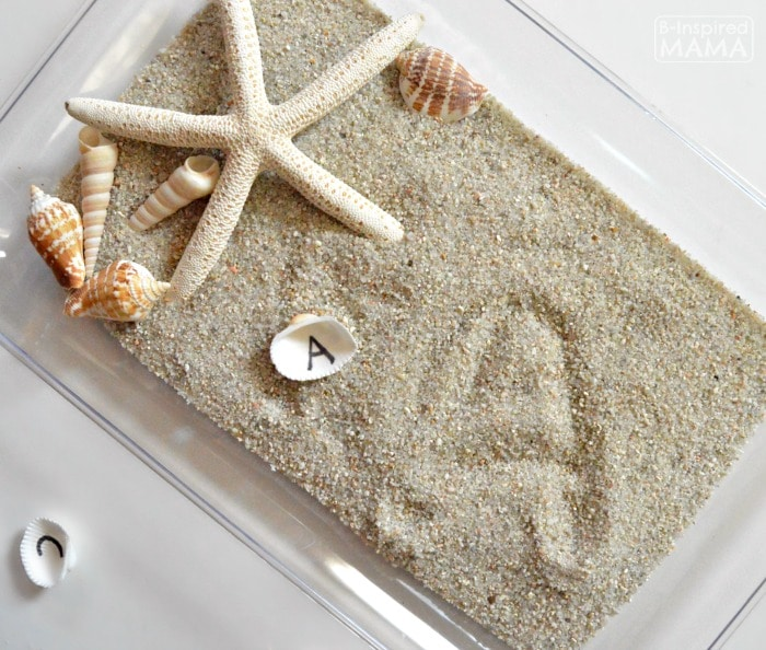 Learning the Alphabet with Seashells and Sand Sensory Writing - Practicing Letters - at B-Inspired Mama