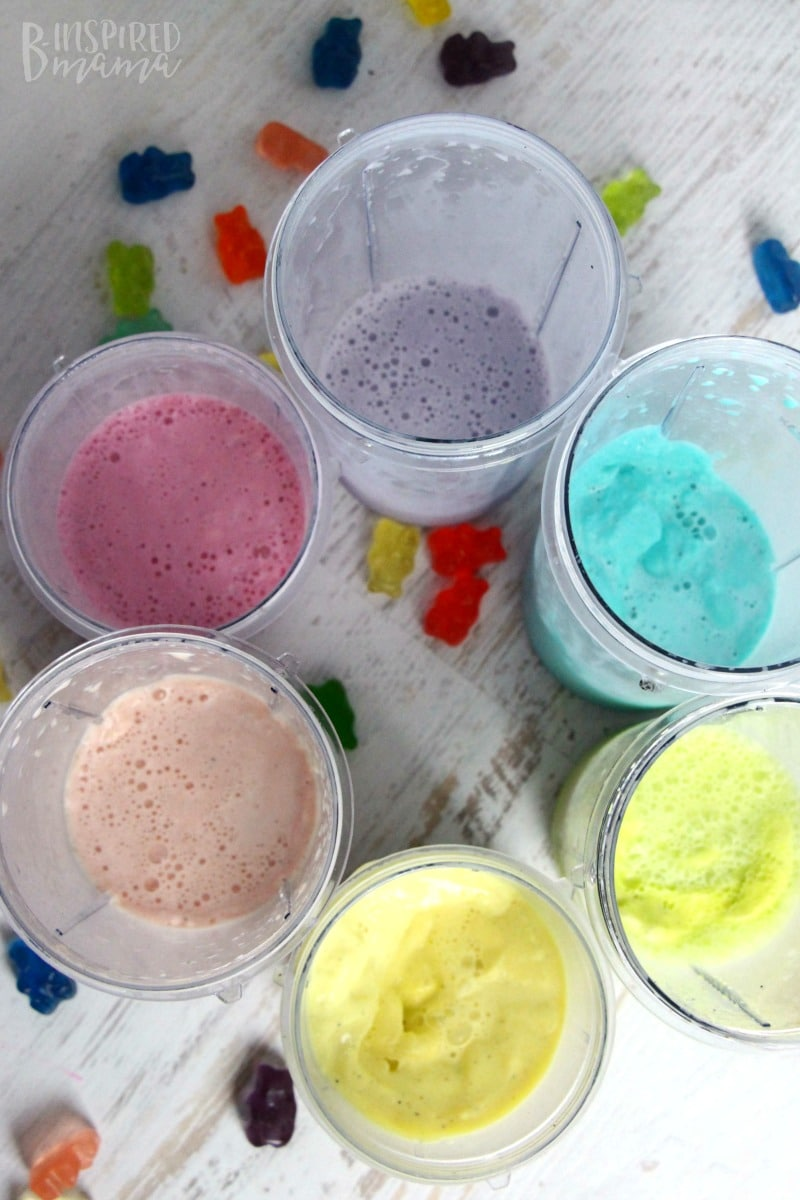 A super easy and seriously fun Rainbow Gummy Bear Milkshake Recipe - Making colorful milkshakes to layer - at B-Inspired Mama