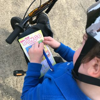 JC having fun playing Kids Bike Bingo - Making Learning to Ride a Bike Fun