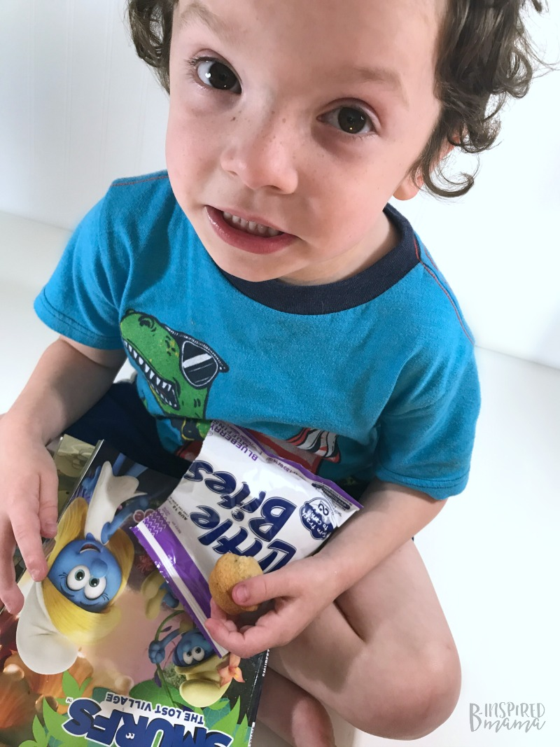 My JC snacking on his Little Bites Smurf Blueberry Muffins while enjoying the SMURFS