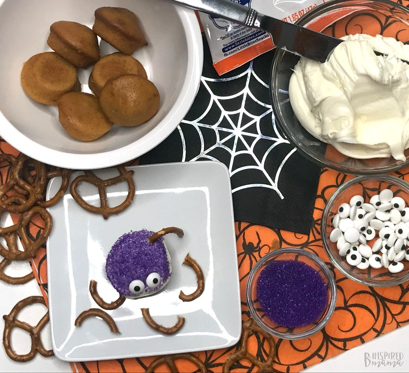 Adding Pretzel Legs - Spider Bites for a fun Halloween Snack for Kids