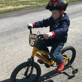 J.C. riding his awesome Schwinn SmartStart Bike + Kids Bike and Kids Bike Helmet Sizes - Made Easy