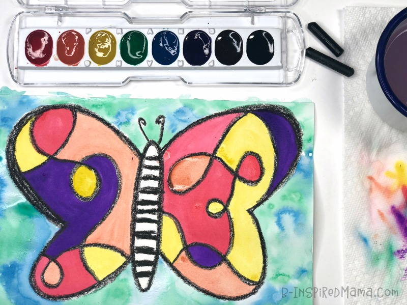 Adding bright colors to our Watercolor Butterfly - A Super Fun Watercolor Painting for Kids