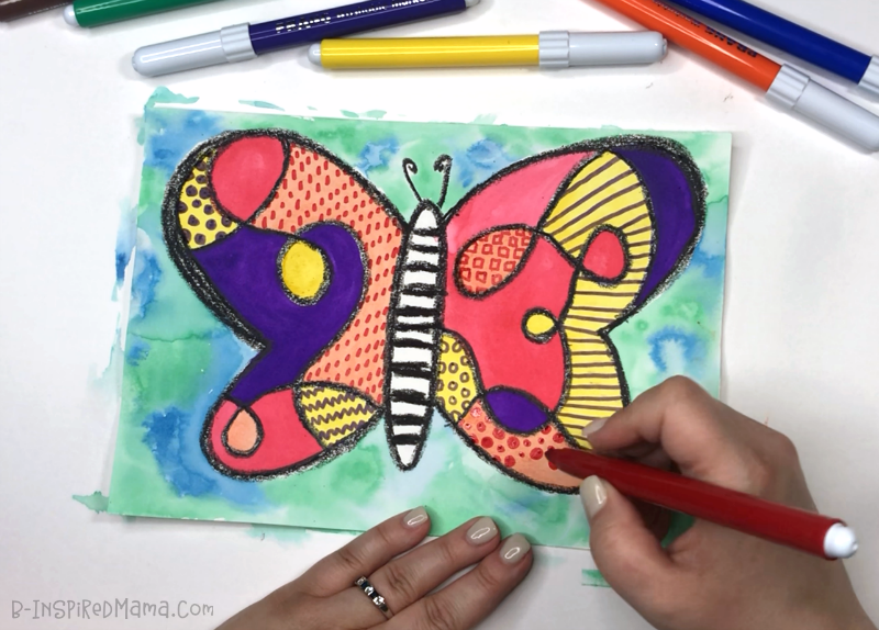 Adding funky patterns to our Crazy Colorful Butterfly Watercolor Painting for Kids!