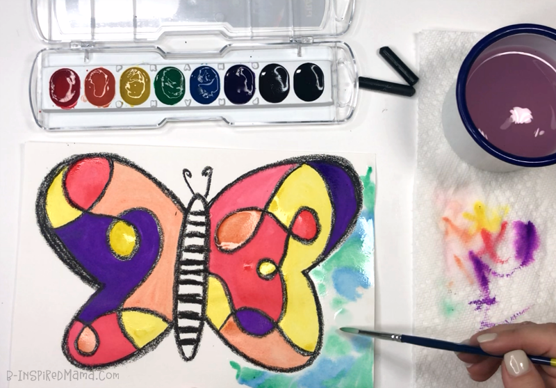 Painting the background of our Crazy Colorful Butterfly Watercolor Painting for Kids!