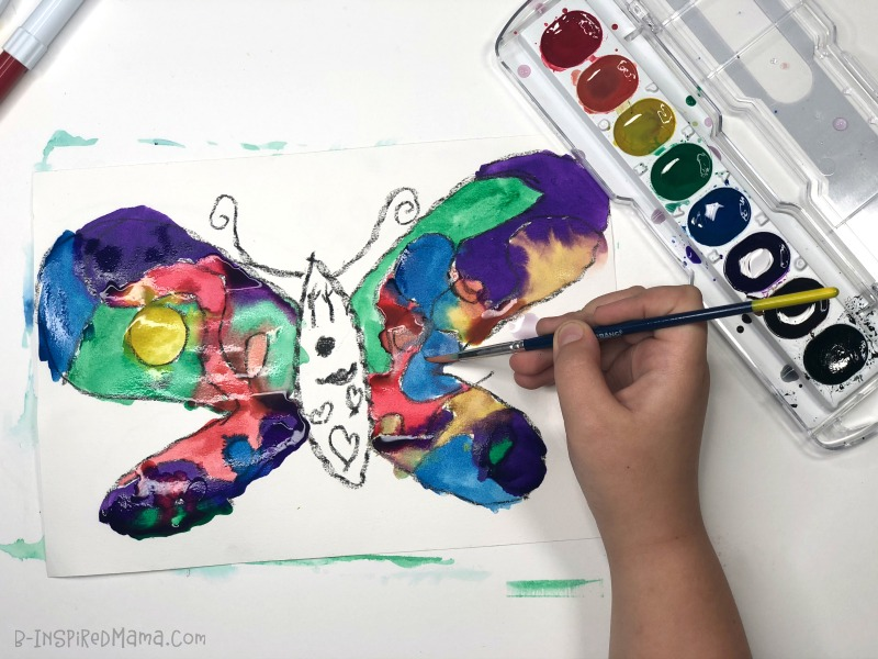 Priscilla painting her Crazy Colorful Butterfly Watercolor Painting