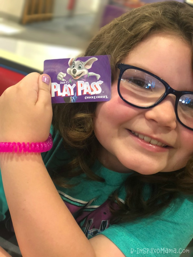 Priscilla showing off her Play Pass during our Awesome Indoor Fun for Kids at Chuck E. Cheese's