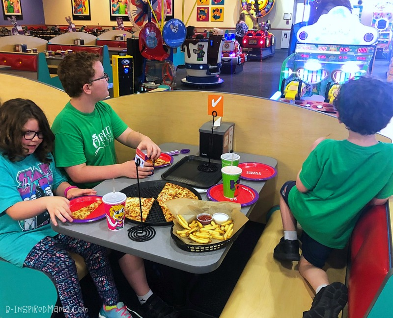 Taking a break for pizza - during our Indoor Fun for Kids at Chuck E. Cheese's
