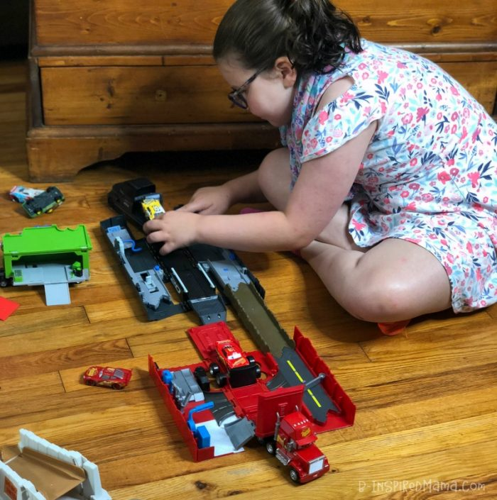Priscilla playing with our new Cars 3 toys