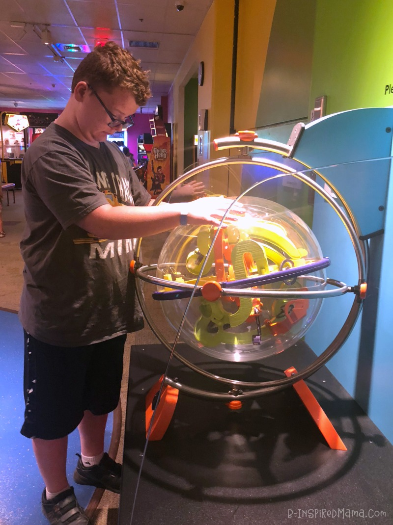 Sawyer playing with the giant Perplexus toy - at The Strong National Museum of Play